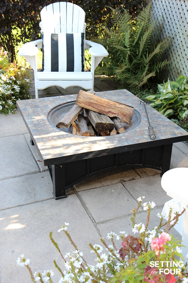 See our clever wood storage idea to keep fire wood dry! This is a helpful storage tip if you have a fire pit, wood burning fireplace or wood stove too! www.settingforfour.com