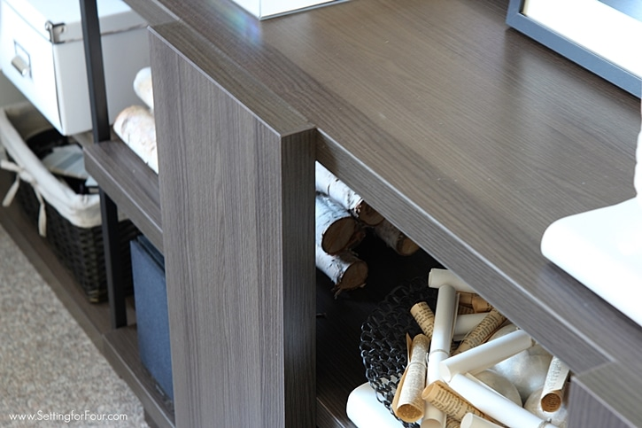 This console table in a home office is a clever storage idea for placing the printer and decor. www.settingforfour.com