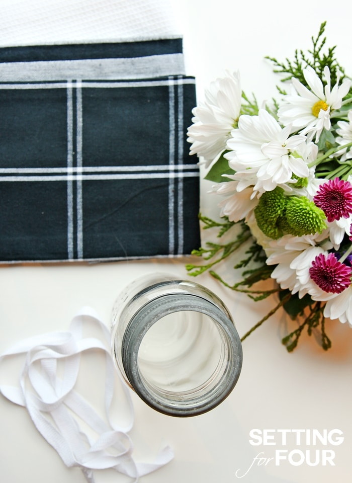 See how to make this Quick and Easy Hostess Gift that will impress! Mason jar of flowers in a tea towel wrapper. www.settingforfour.com