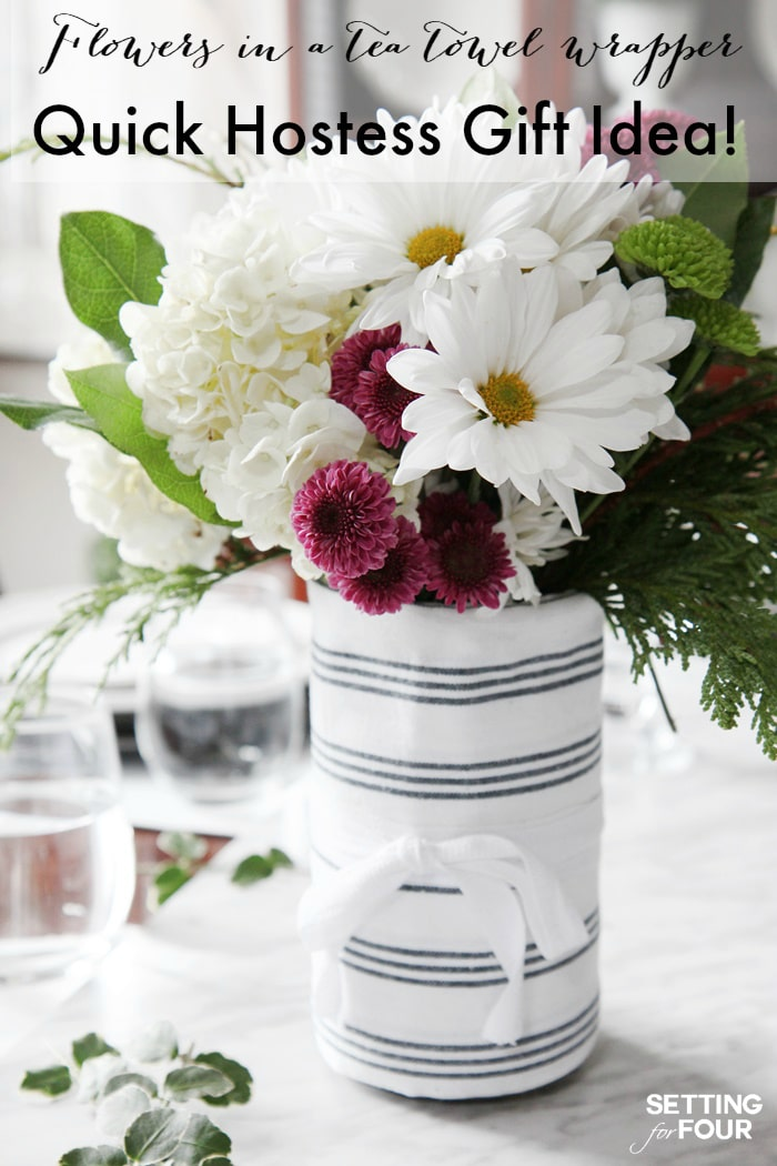 Gorgeous! Quick and Easy DIY Hostess Gift Mason Jar Of Flowers! It's 3 gifts in one - a bouquet of flowers, a mason jar and a pretty tea towel wrapper, that the hostess can use later!