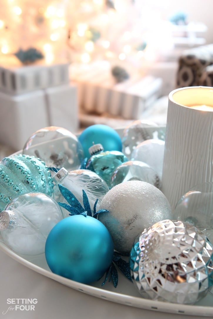 Create a beautiful luminous Christmas centerpiece tray in just 10 minutes to cozy up your home for the holidays and display your favorite Christmas ornaments! Such a fabulous festive way to decorate your coffee table, dining table or kitchen island in record time. www.settingforfour.com