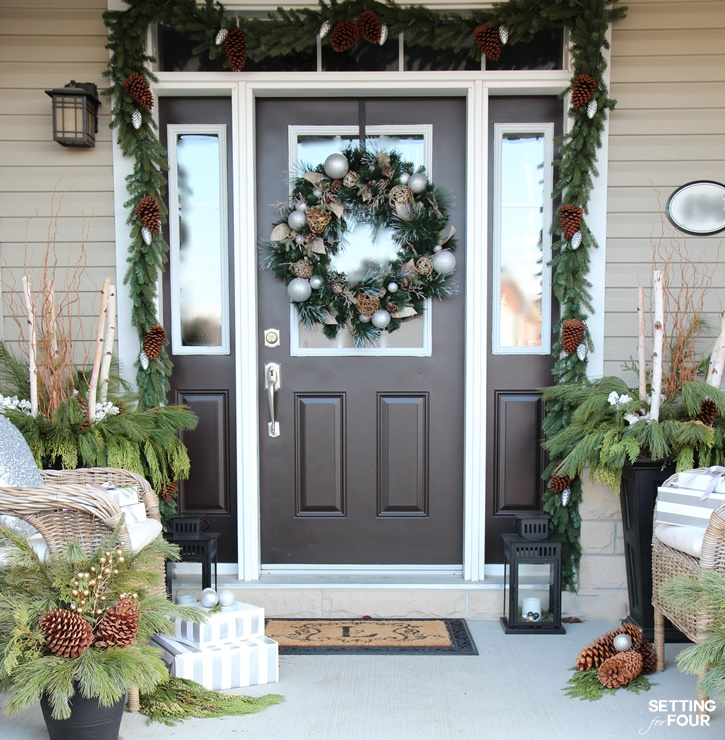 Come see all of my Holiday Cheer Outdoor Christmas Decorations and Christmas Entryway Home Tour. I show you how I love to add holiday curb appeal to my home with planters, wreaths and garland! www.settingforfour.com