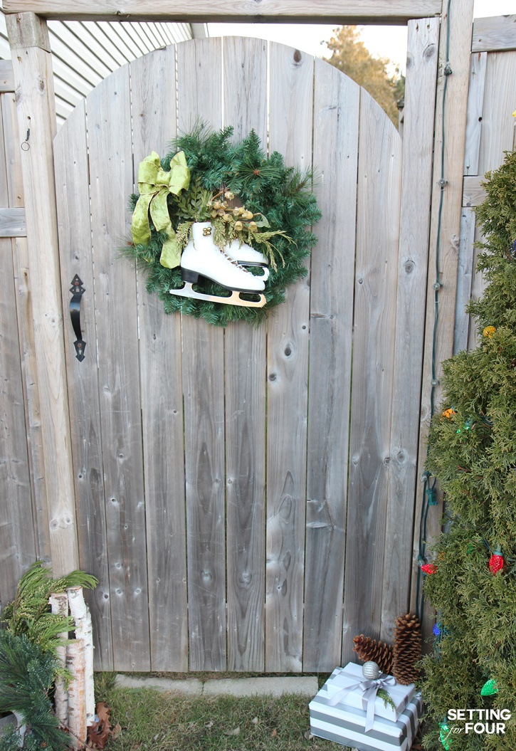 DIY Vintage ice skate wreath dresses up a side gate for the holidays - love this idea! www.settingforfour.com