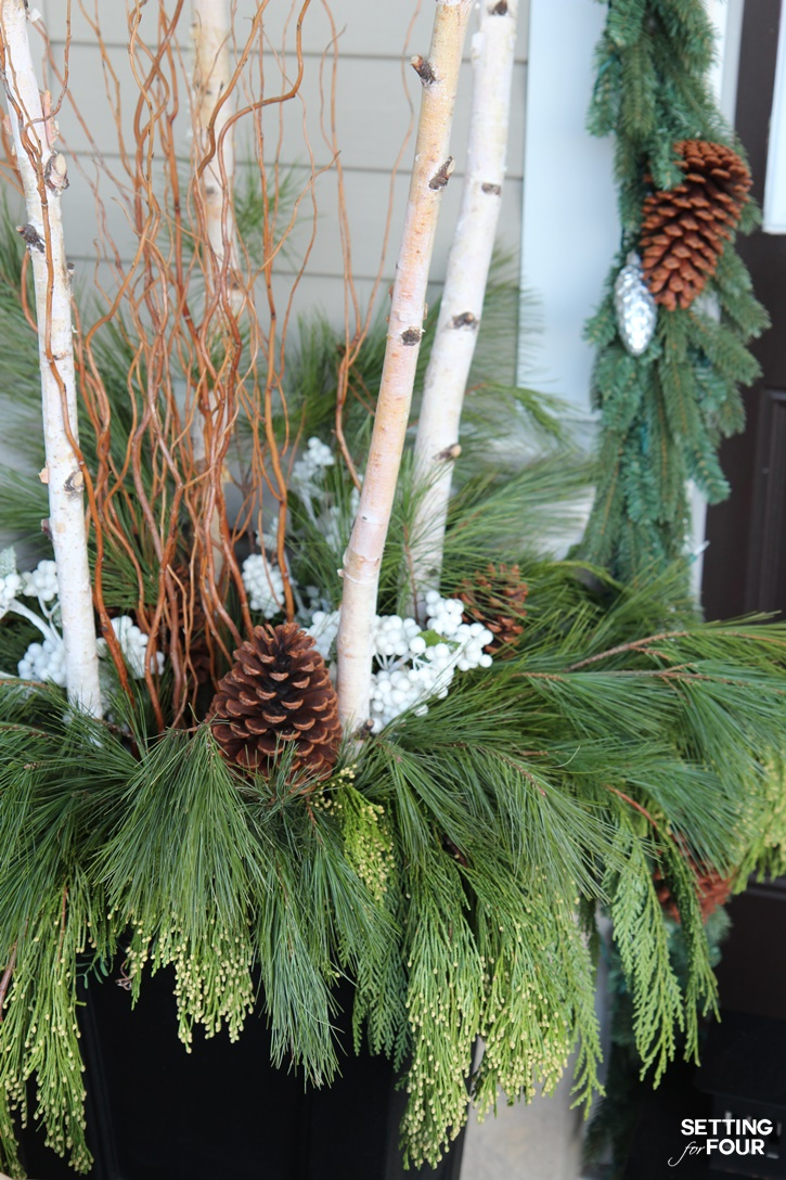 Come see all of my Holiday Cheer Outdoor Christmas Decorations and Christmas Entryway Home Tour. Adding planters filled with birch, curly willow and fresh pine is a great way to add curb appeal! www.settingforfour.com
