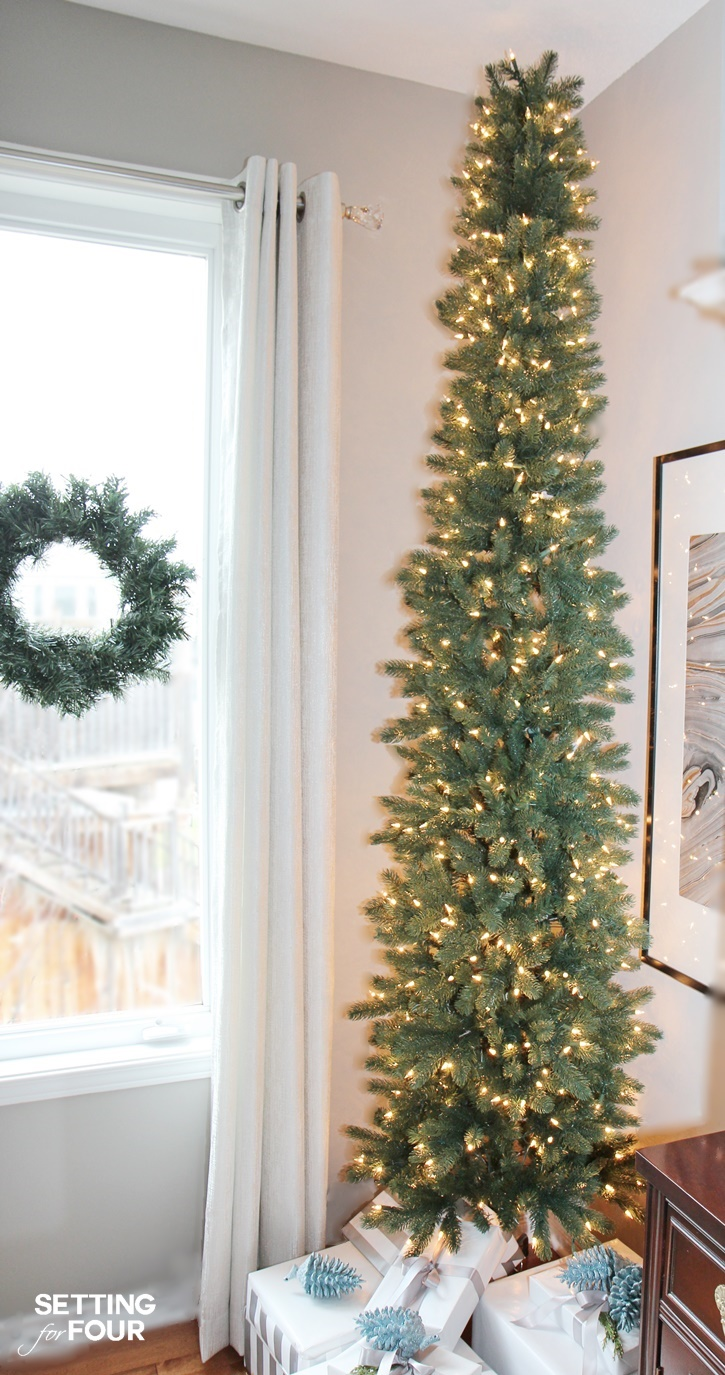 Aa PENCIL CHRISTMAS TREEa Pencil Christmas Tree is the perfect holiday solution for decorating narrow spaces like foyers, hallways and corners! Come see mine at www.settingforfour.com.