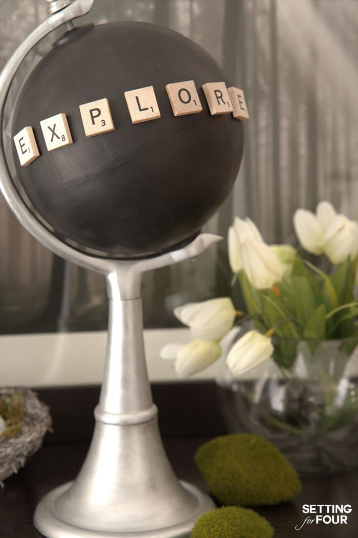 Make a pretty Chalkboard Globe in a jiffy with a globe, paint and Scrabble letters! Just 4 easy steps is all it takes to turn an old globe into this beautiful decor accessory. Customize it by spelling out a special word with scrabble letters. The chalkboard paint allows you to write notes or draw pictures too - how fun!