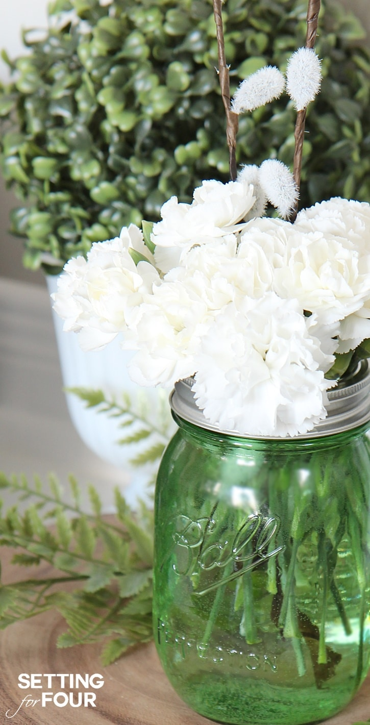 10 Minute Mason Jar Craft Idea: See my budget saving secret to making these gorgeous diy green mason jar centerpiece!