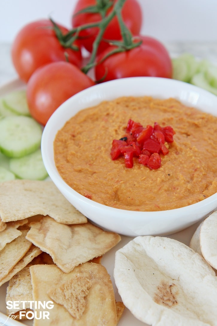 Roasted Red Pepper Hummus with Sun-Dried Tomatoes: Bored with your every day snack routine? Mix it up with the NEW BUSH'S® Hummus Made Easy in a pouch - a homemade, creamy hummus recipe that you can whip up in just three simple steps! Just 5 minutes to prepare. You'll love this easy vegetarian recipe - makes a quick and delicious party dip and spread. Get the recipe at Setting for Four.