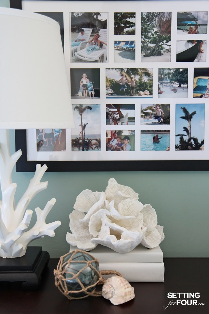 Dresser vignette with shells, table lamp and family photos