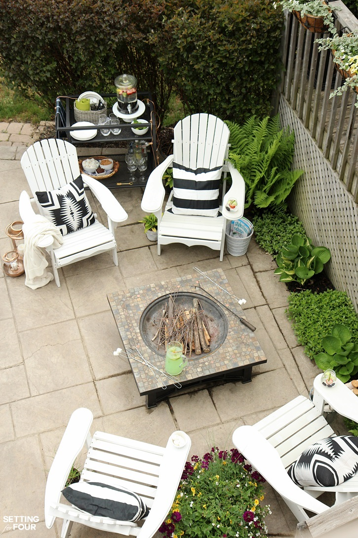 See our outdoor fire pit seating area, the DIY Adirondack chairs my family loves to relax in, outdoor bar cart and simple outdoor summer decorating ideas!
