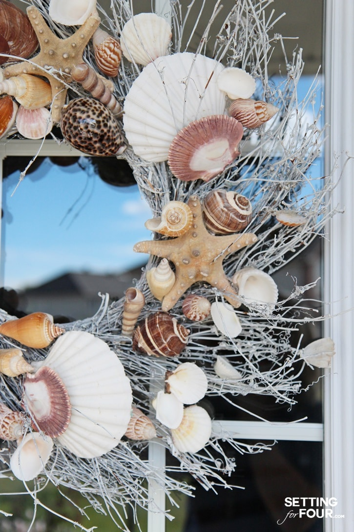 A shell wreath welcomes guests to your home and adds curb appeal!