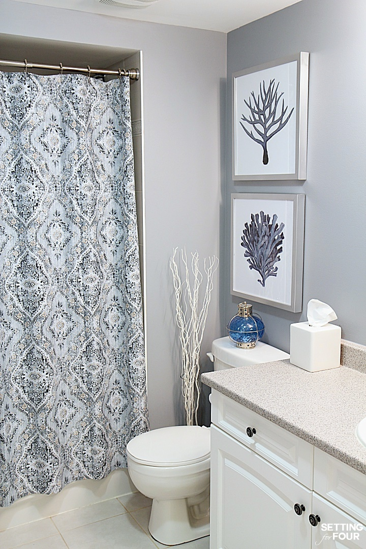 Height measurements and how to hang pictures in a bathroom for Bathroom decor above toilet
