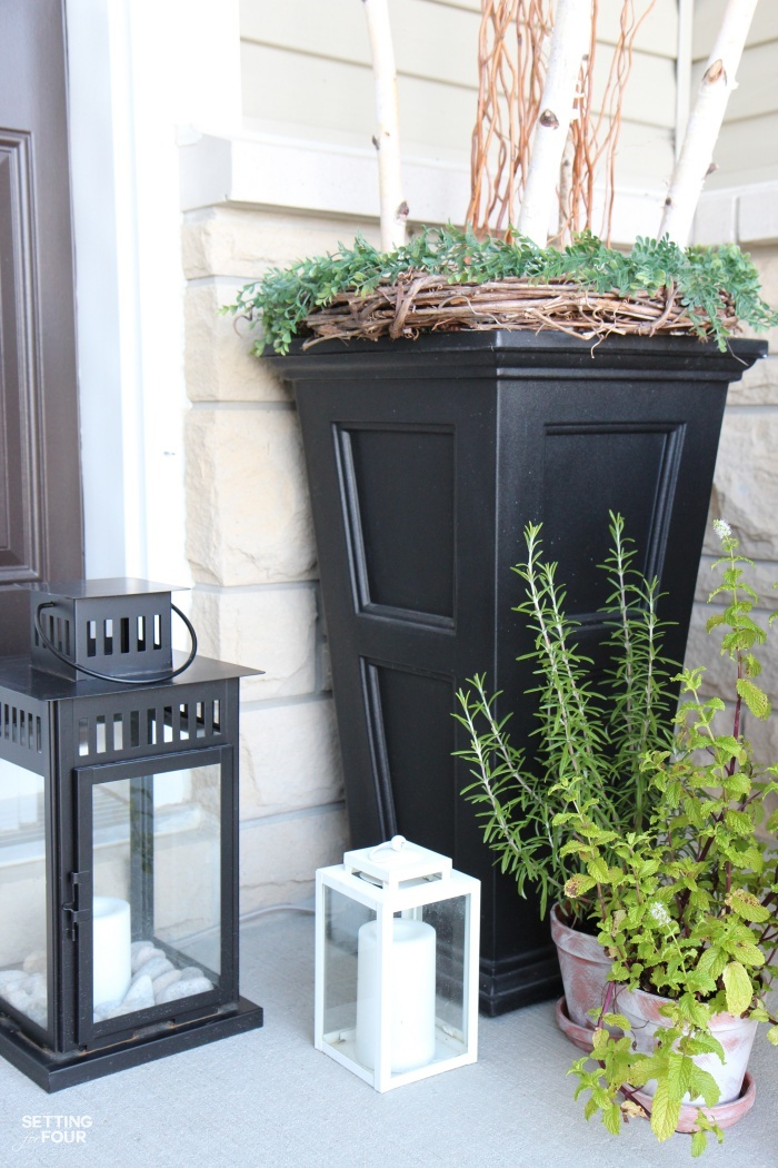 Outdoor front porch urns filled with curly willow and birch branches give this porch huge impact and curb appeal!