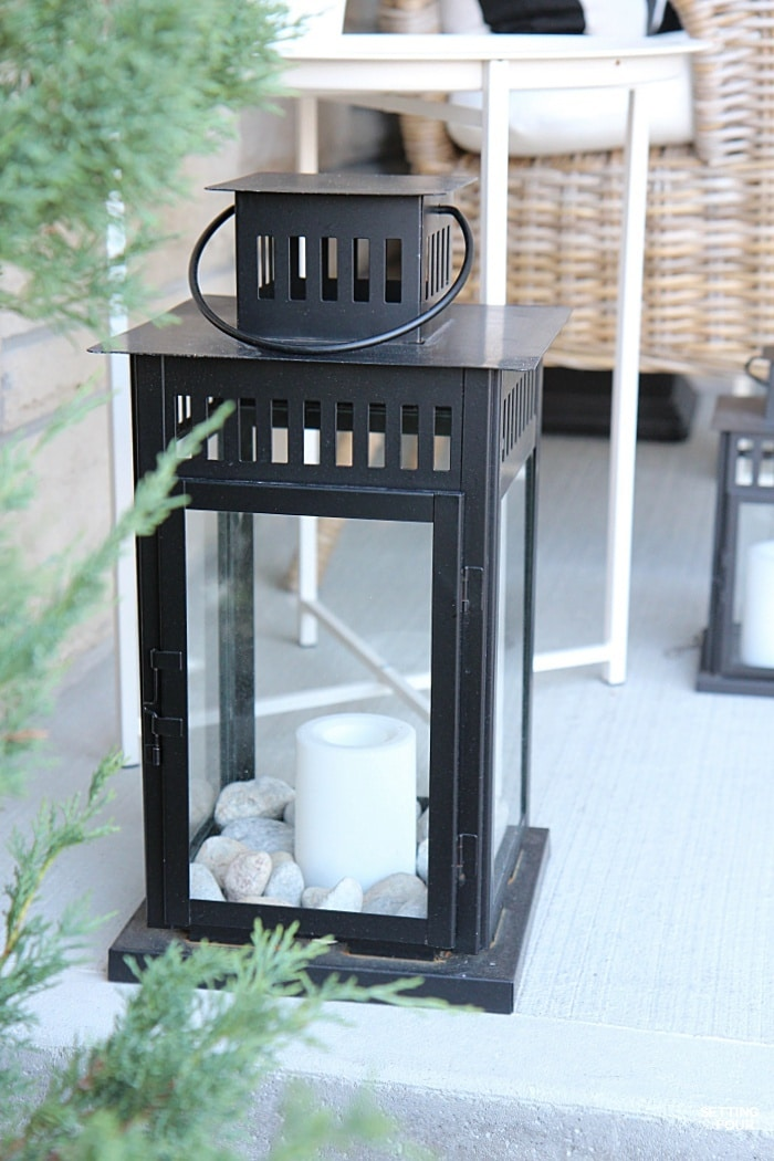 Outdoor lanterns with timers add a pretty twinkle to the front porch at night!