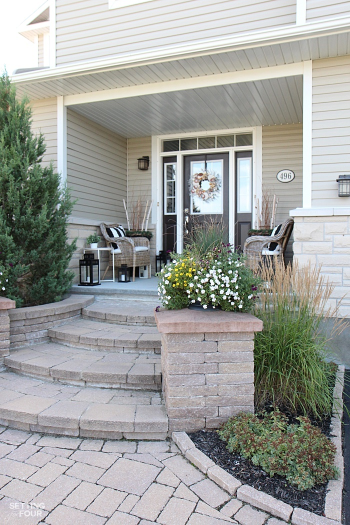 This is the front view of our home. I love the wide curving stone steps, pillars and walkway!