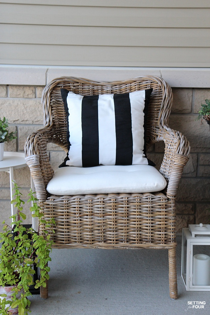 Outdoor wicker chairs with pillows and weatherproof cushions. Perfect for our front porch!