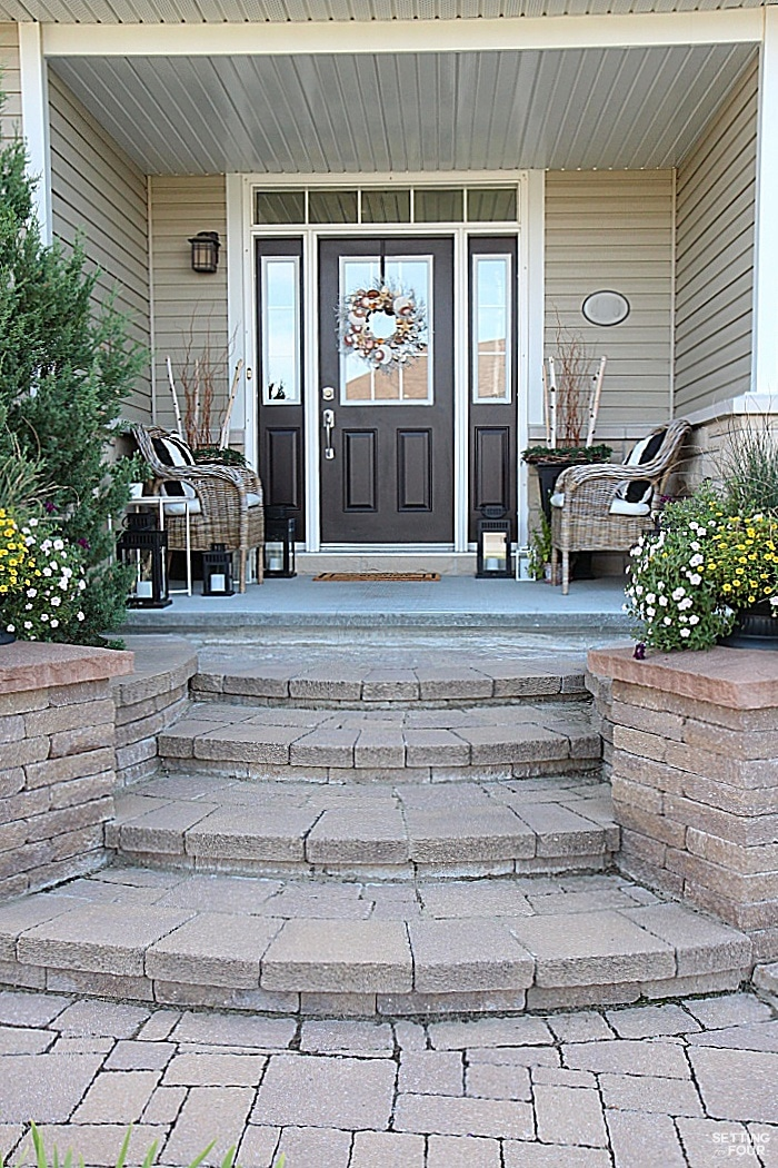 Our home has pretty curb appeal with the gorgeous design of these inlaid stone steps, stone pillars and covered entryway.