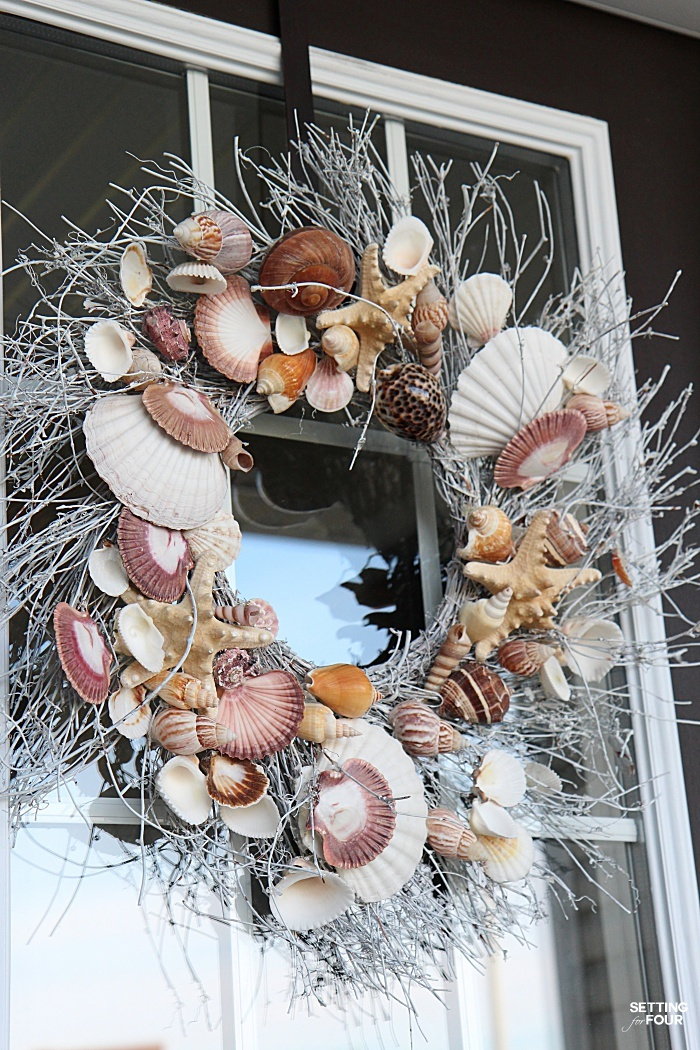 See the wreath hanger I use for our front door wreath. The wreath never falls off and stays put!