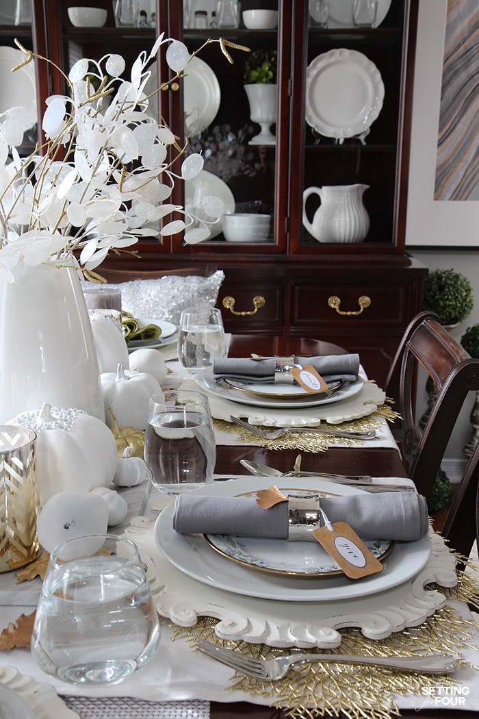 Holiday centerpiece and table setting ideas don't have to break the bank! See how you can create an elegant holiday table like this - for less!