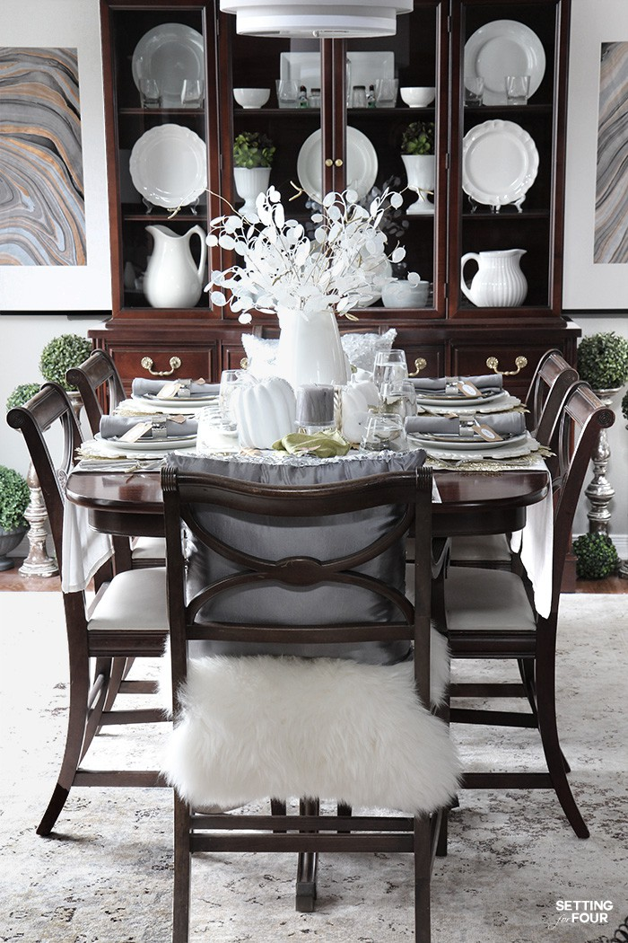 Dining room decorated for a Thanksgiving dinner party. Elegant and easy decor ideas. #centerpiece #thanksgiving #diningroom #decor #fall #party