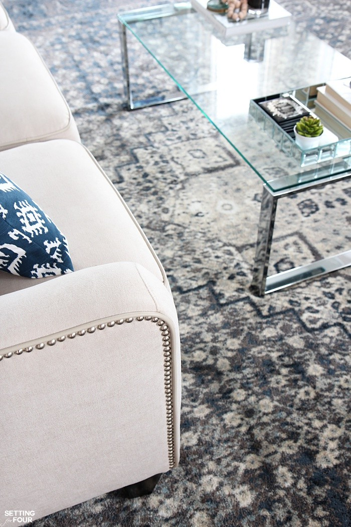Loving this Indigo Blue Color Scheme for a Living Room - looks gorgeous with this cream sofa and glass and chrome coffee table!