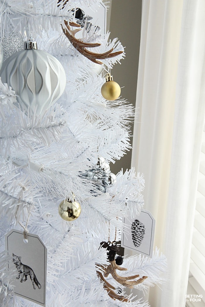 White Christmas tree with rustic glam ornaments.