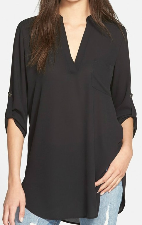 Black 'Perfect' Swingy Tunic: I LOVE the long, swingy silhouette of this tunic! The graceful movement and smooth split-neck tunic styled with roll-tab sleeves and a high/low hem is perfection. This is one of those tops you will wear over and over again - can be dressed up and dressed down! Add this comfy tunic to skinny jeans and booties or leggings and riding boots with a pendant necklace or a bejeweled bib necklace!
