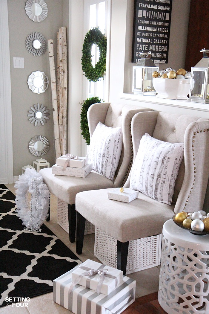 Elegant and neutral christmas foyer setting for four for Elegant foyer decor