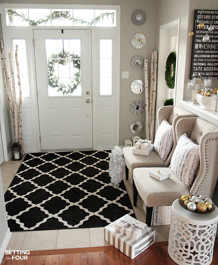 Elegant and neutral christmas foyer setting for four for Decorating your foyer
