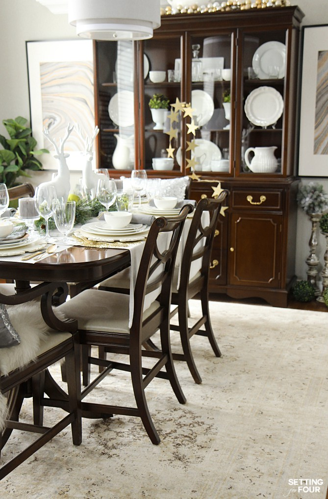 Christmas Home Decor Ideas: See this design bloggers holiday dining room and elegant white and gold tablesetting!