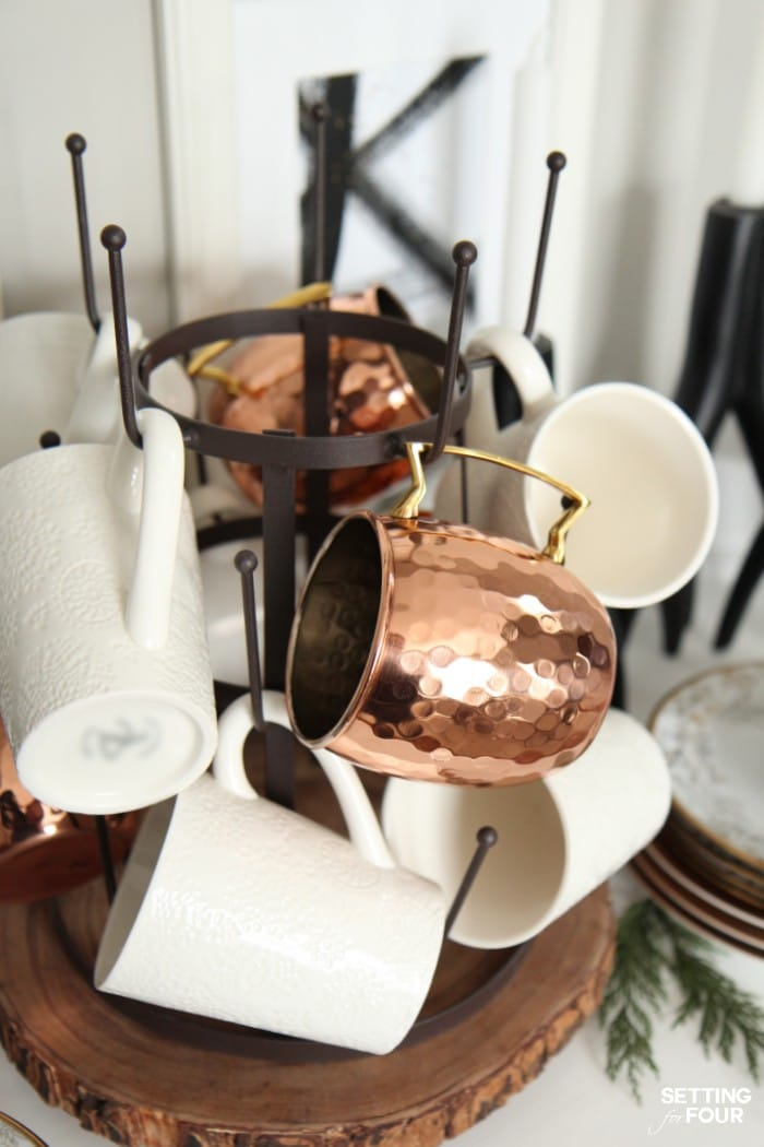 Copper Mugs displayed on a wire glass drying rack.