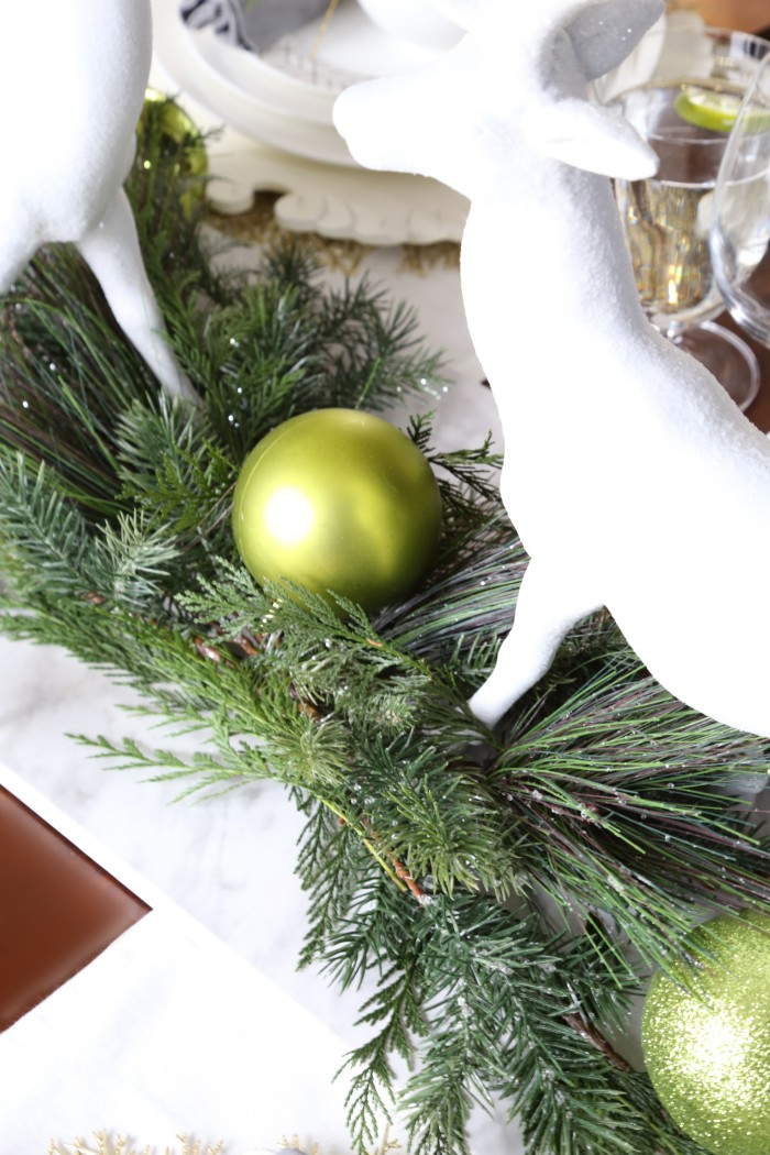 Learn how to make a rustic, chic Christmas centerpiece for a festive dining table with step by step instructions in this fun design lesson!