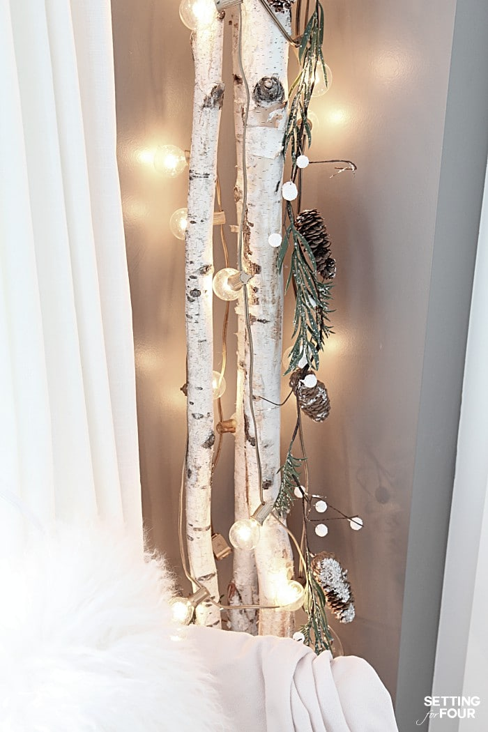 See how to make this quick 10 Minute Winter Decorating Idea with Birch Poles! A great way to decorate a small space in your home! Perfect for apartments and condos!