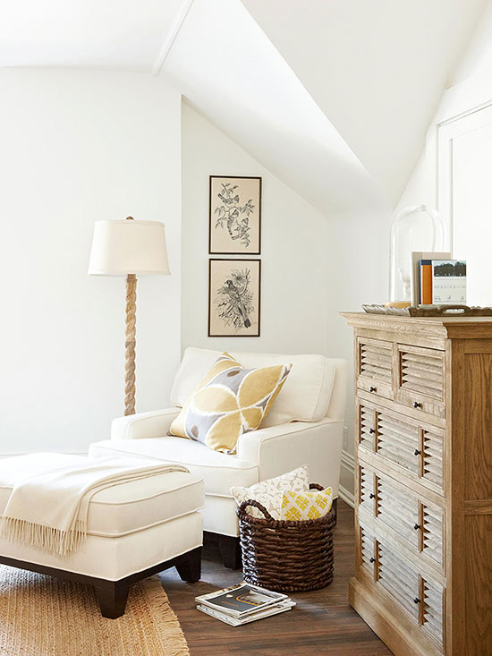 A cozy reading nook starts with a comfy chair, ottoman, pillows and throw blankets! Beautiful home decor idea.