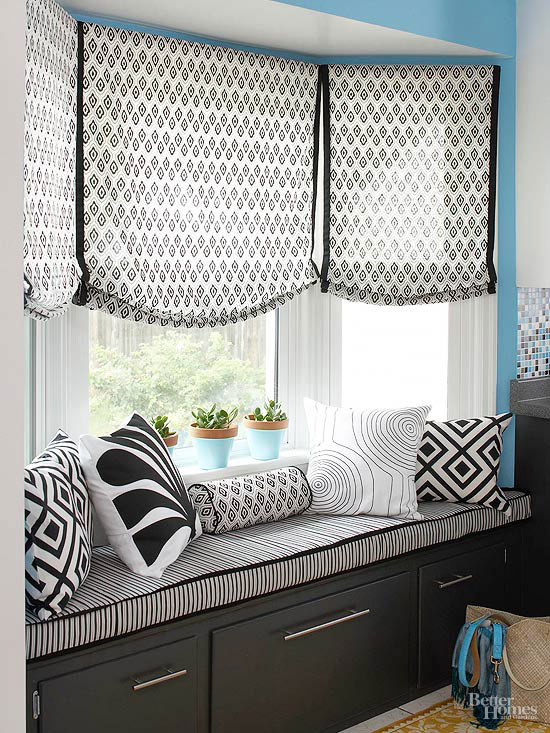 Cozy window seat with gorgeous shades, storage drawers, pillows and seat cushion! Beautiful home decor idea.