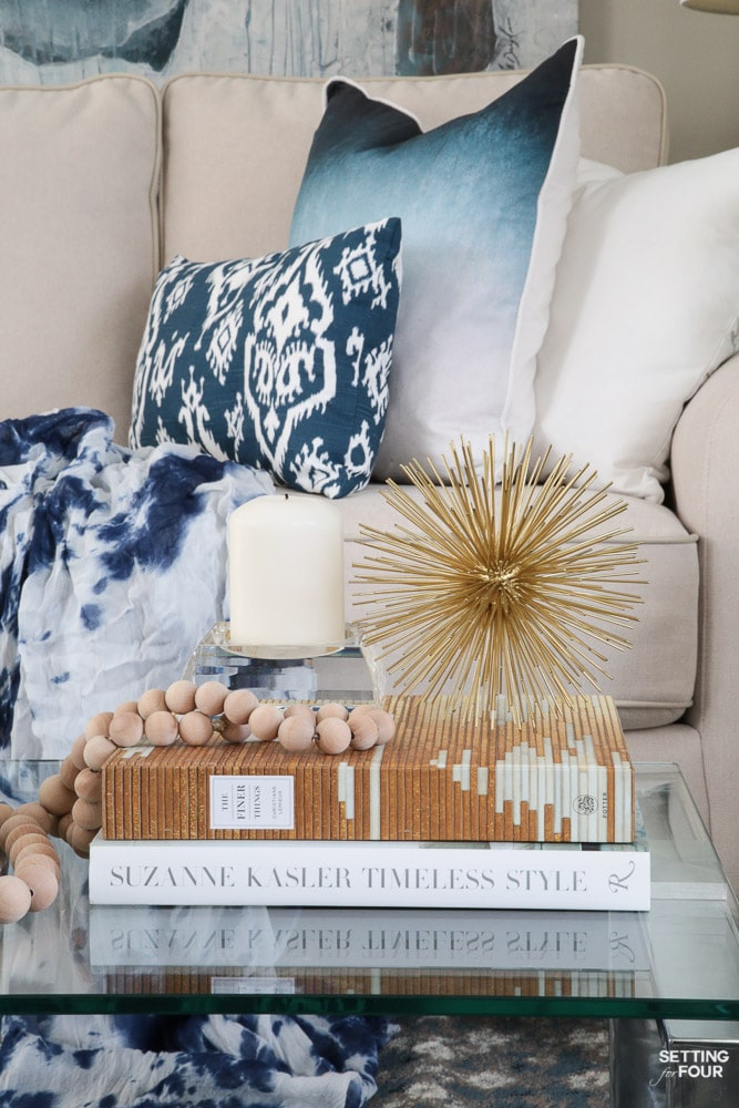 See my coffee table styling tips and ideas using design books and metallic accents!