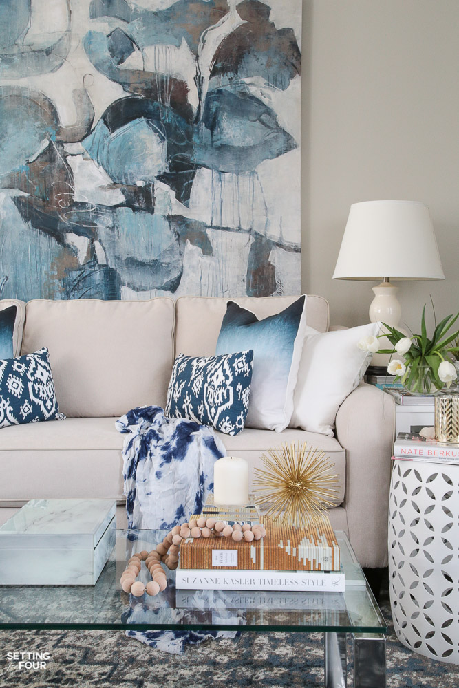 Large oversized art is a design trend for 2018! See all 10 trends in this amazing article where you'll learn how to add them to your home!