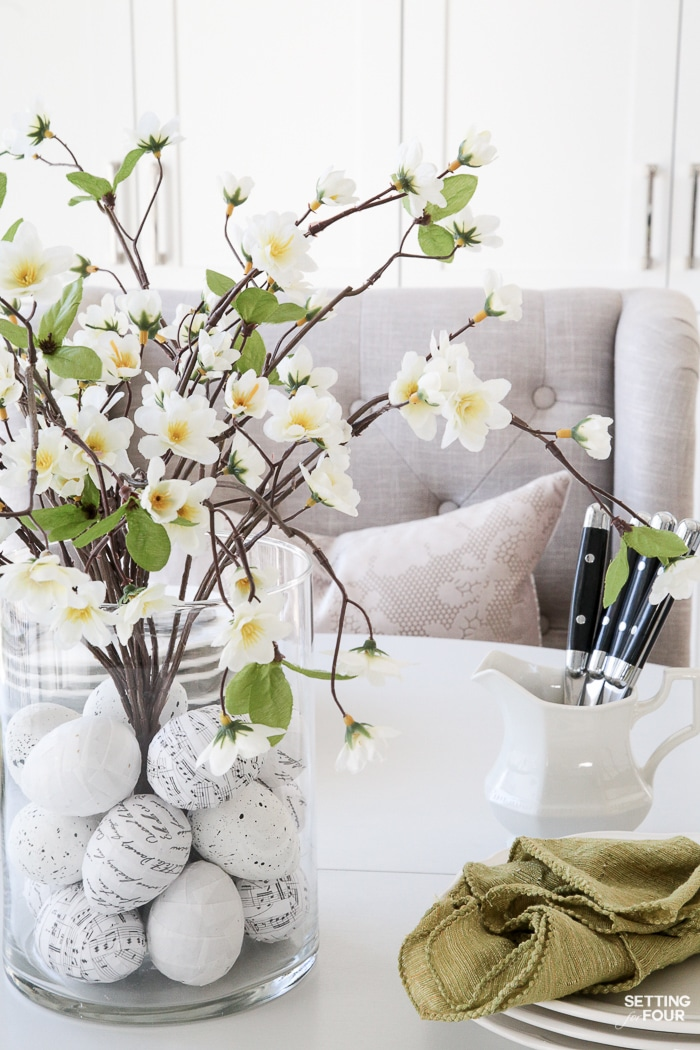 Beautiful 10 Minute Floral Arrangement with DIY Easter Egg Vase Filler. These pretty easter eggs are a great way to hide the flowering branch stems!