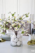 Learn how to make this GORGEOUS quick 10 minute floral arrangement with DIY Easter Egg vase filler! So pretty for a Spring and Easter dining table, kitchen island or coffee table vignette.