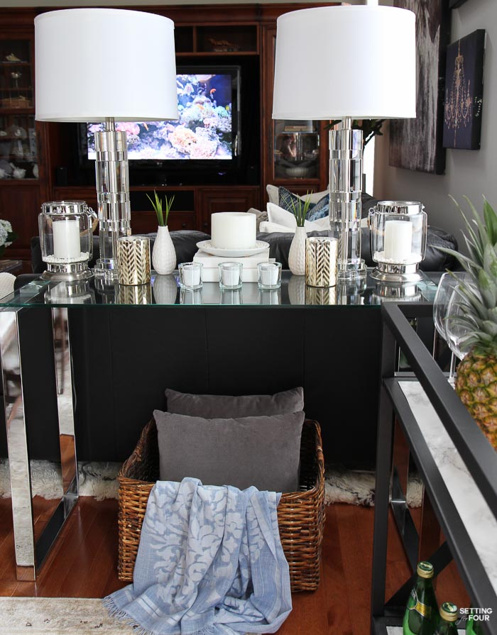 Summer home tour and summer decorating ideas. Console table decor with crystal lamps and candles.