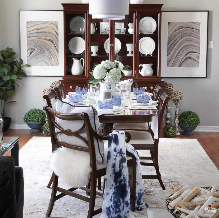 Summer home tour and summer decorating ideas. Dining room with DIY Marbled art, blue dishes, blue hydrangea centerpiece, fiddle leaf fig tree, antique furniture, ironstone dishes, vintage area rug.