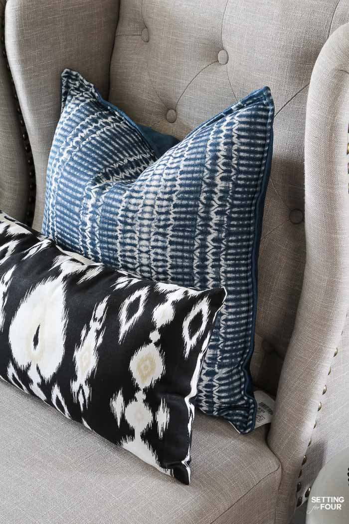 Summer home tour and summer decorating ideas. Foyer with wingback nailhead chairs, indigo shibori pillows, ikat pillows.