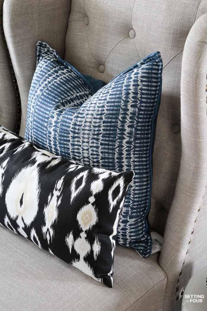 Summer home tour and summer decorating ideas. Foyer with wingback nailhead chairs, indigo shibori pillows, ikat pillows.