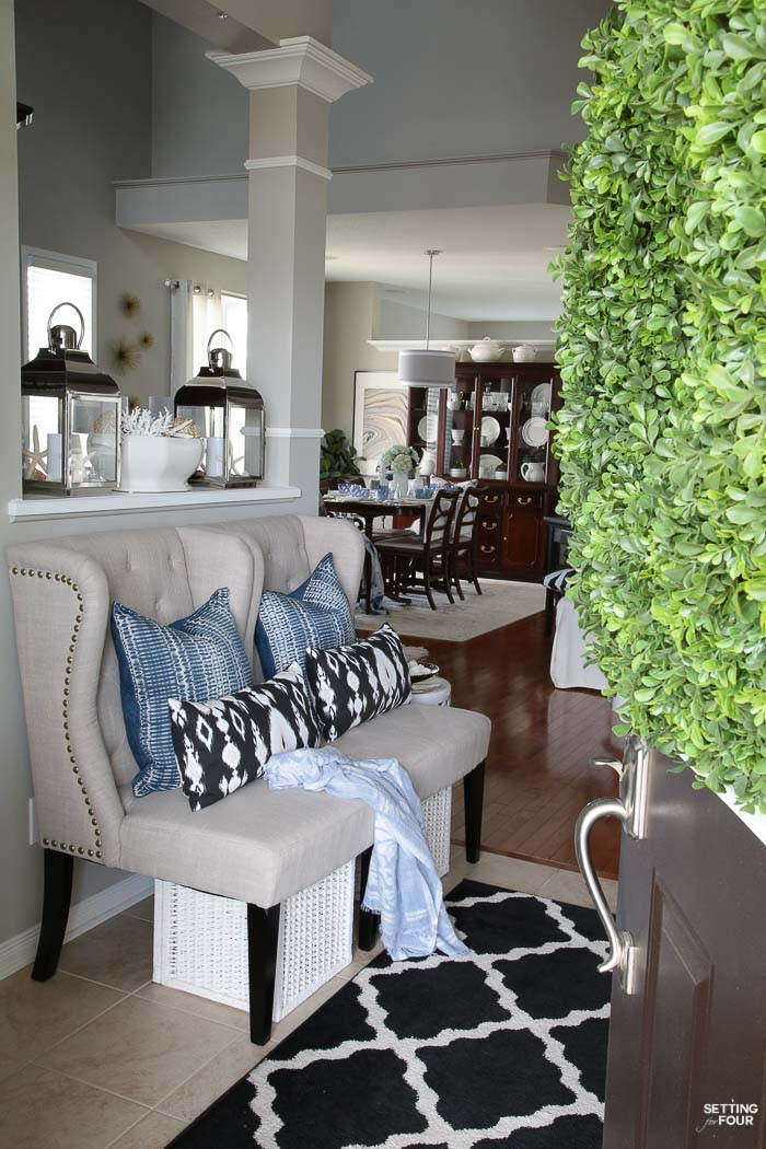 Summer home tour and summer decorating ideas. Foyer with wingback chairs, indigo shibori pillows, ikat pillows and trellis area rug