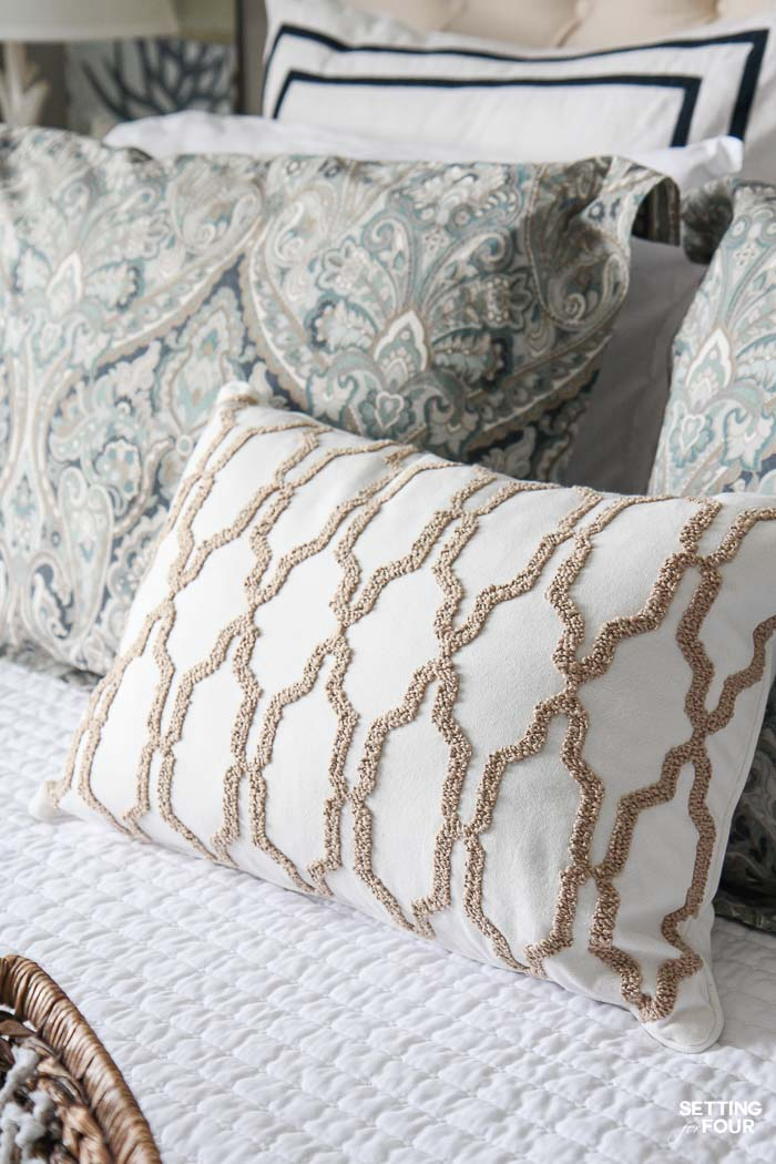 See the 12 ways to create a COZY guest bedroom your company will LOVE! : Add a decorative accent pillow or two.