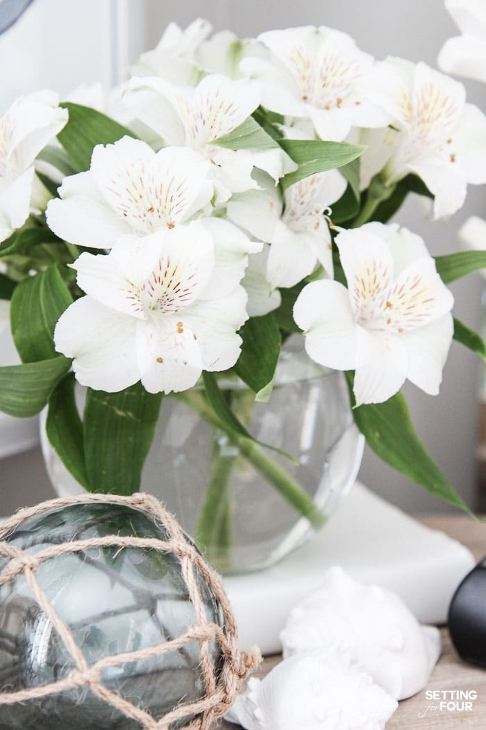 See the 12 ways to create a COZY guest bedroom your company will LOVE! : Add a beautiful vase of flowers for the night table.