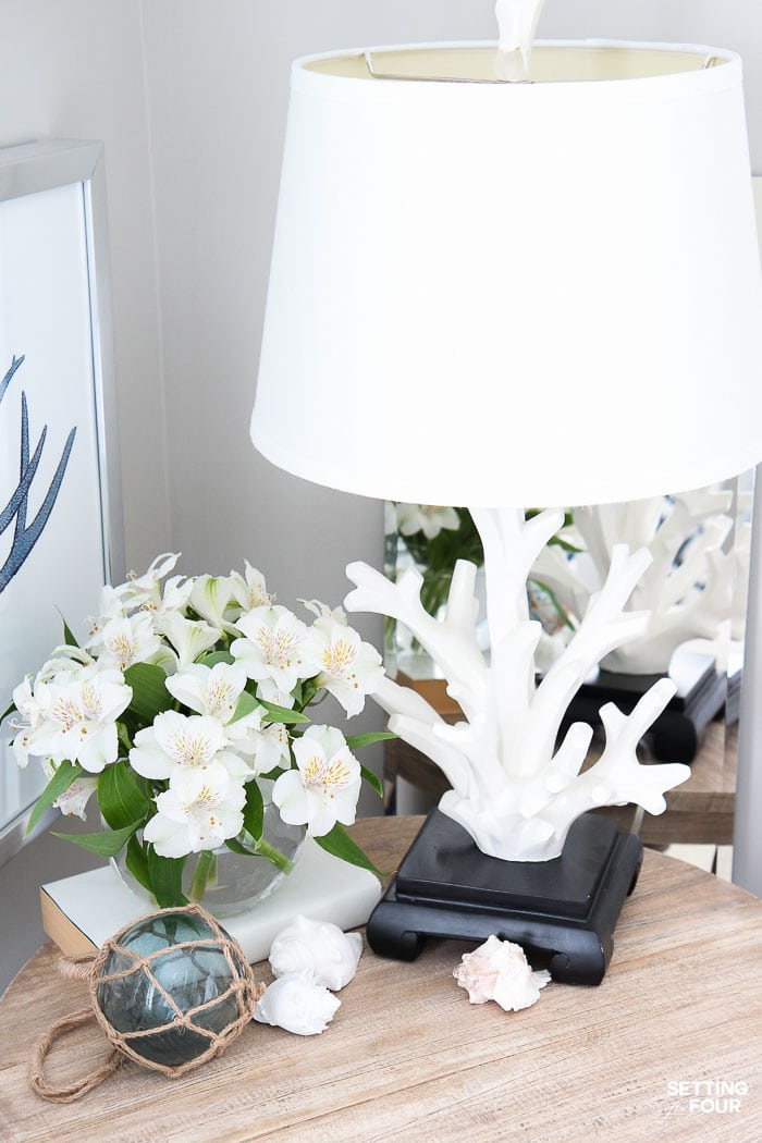 See the 12 ways to create a COZY guest bedroom your company will LOVE! : good lighting with two table lamps.
