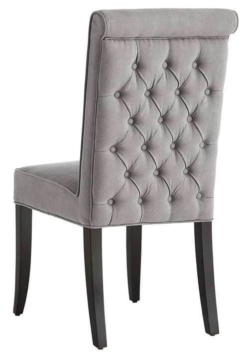 This stunning tufted accent chair is perfect for the dining table or home office.
