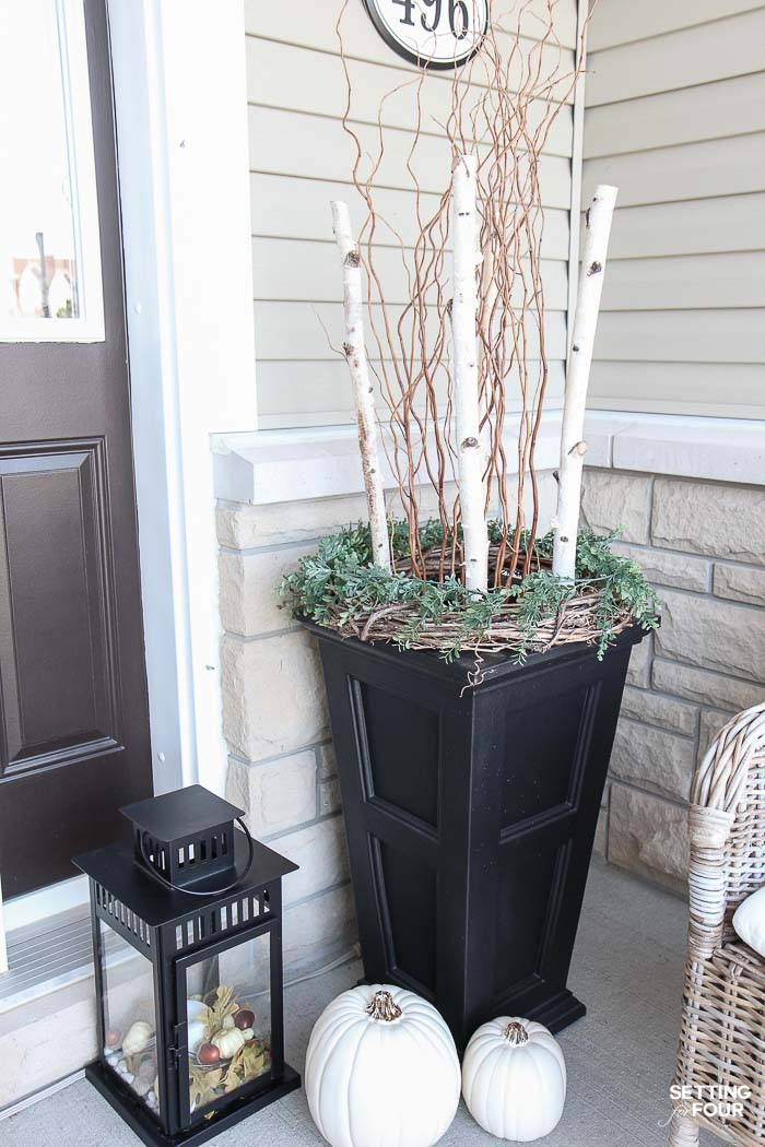 Fall porch decorating ideas: Make these beautiful planters with birch poles and curly willow for a simple rustic look. See how!