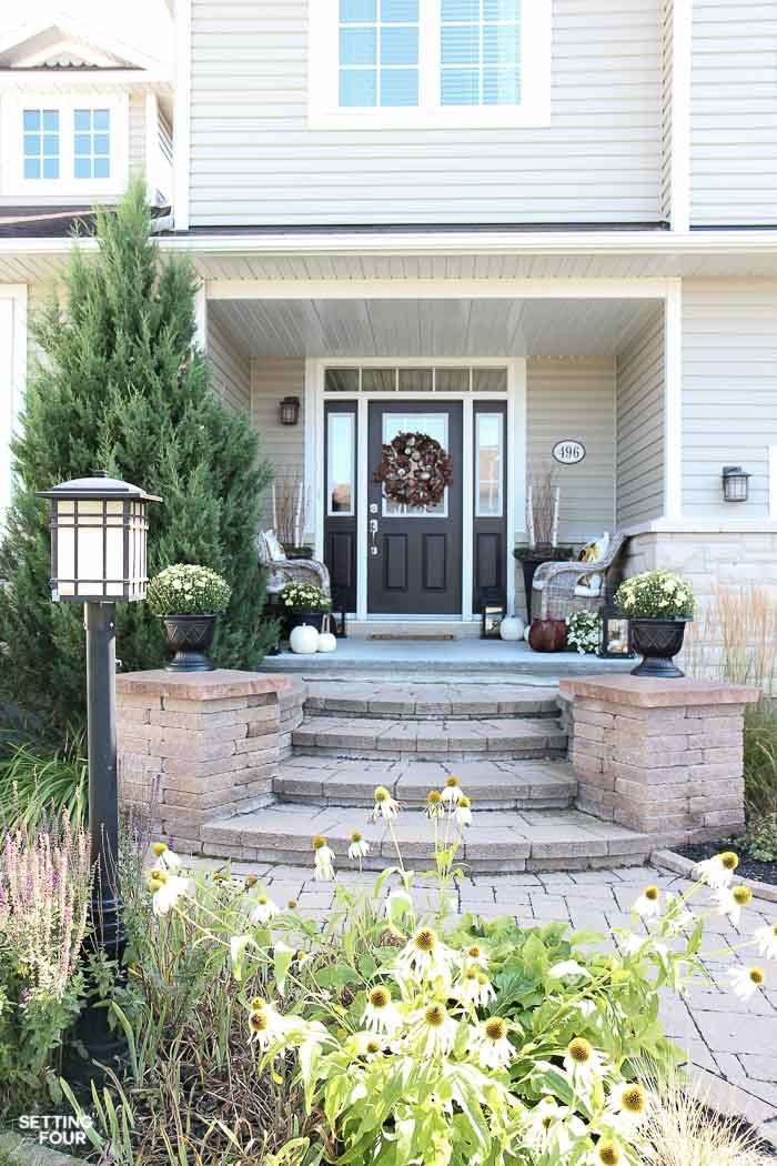 Looking for new ideas to decorate your Front Porch? Come see my COZY RUSTIC FALL PORCH Decor with lots of DIY home decor ideas to add curb appeal to your home! Easy fall decorating ideas for using pumpkin decorations, fall planters, mums, fall wreath, lanterns and more! See all the porch decorating tips!